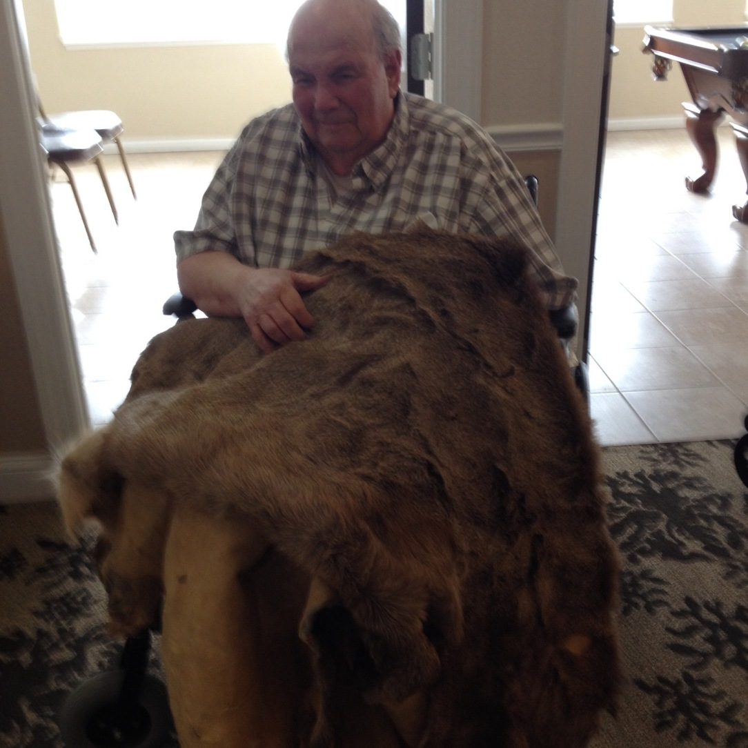Brook holding elk pelt